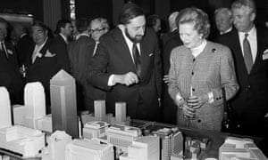 Margaret Thatcher is shown a model of the proposed development at Canary Wharf in London.