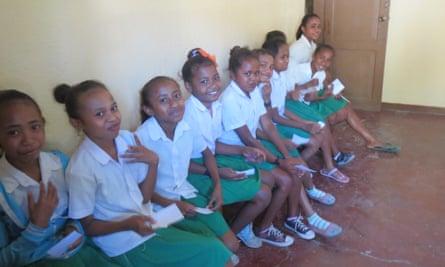 Timor Leste schoolgirls lining up for dental treatment.