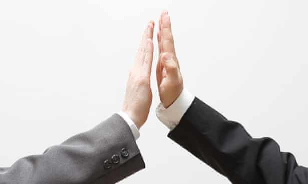two businessmen doing high five
