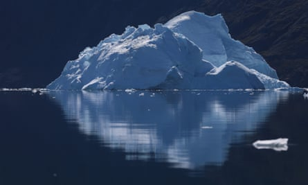 ILULISSAT, GREENLAND - JULY 21:  An iceberg floats through the water on July 21, 2013 in Ilulissat, Greenland. As the sea levels around the globe rise, researchers affiliated with the National Science Foundation and other organisations are studying the phenomena of the melting glaciers and its long-term ramifications. The warmer temperatures that have had an effect on the glaciers in Greenland also have altered the ways in which the local populace farm, fish, hunt and even travel across land.