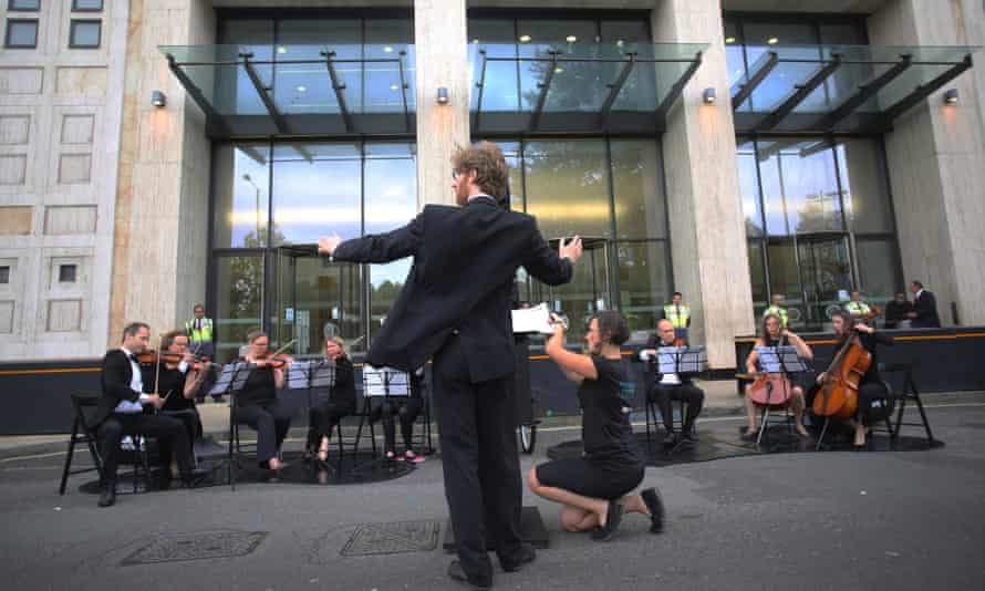 The Crystal Palace Quartet and supporting musicians perform orchestral protests against Arctic drilling outside Shell's offices on the South Bank, London.