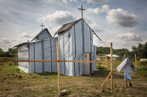A woman enters the site of a church in a make shift camp near the port of Calais.
