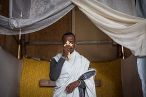 Kibrom Kasta leads an Orthodox service for Ethiopian and Eritrean worshippers.