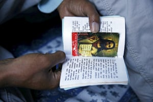Christian migrants from Eritrea and Ethiopia pray and read the bible before Sunday mass at the makeshift church