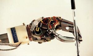 1997 ROBOT HAND HOLDING PEN