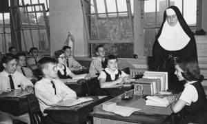 Nun teaching children