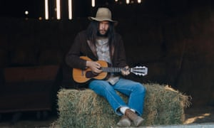 Hey, hay … Neil Young sits on some straw in 1971.