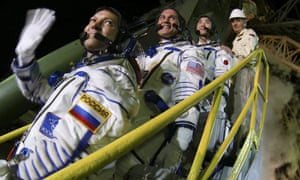 Roscosmos cosmonaut Oleg Kononenko, Nasa astronaut Kjell N Lindgren and Japanese astronaut Kimiya Yui prepare to board a Soyuz capsule bound for the international space station.