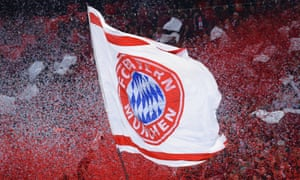 Fans wave a Bayern Muenchen flag during the UEFA Champions League Quarter Final