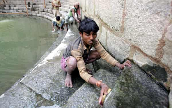 Workers carry out conservation work at Hazrat Nizamuddin Auliyas baoli in New Delhi.