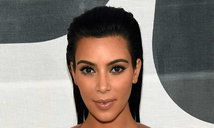 Kim Kardashian shows off her mega-brows.