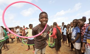 Children play with hula hoops in Chiputo, eastern Mozambique as part of an International Inspiration programme delivered by Unicef.