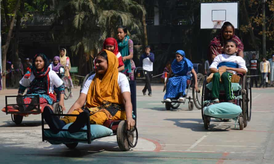 Wheelchair basketball players leave the court at a quarterly Sports Day for patients at the Centre for the Rehabilitation of the Paralysed, Bangladesh.