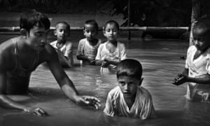Trained S4D swimming instructors teach a survival swimming lesson to children at a village in Narsingdi, Bangladesh. Every year, around 17,000 children die from drowning in this flood-prone country.