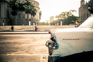 An old car in front of El Capitolio, Havana. The building is home to the Cuban Academy of Sciences.