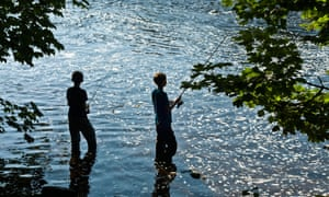 Two boy anglers fishing in River Wharfe, West Yorkshire in 2010.