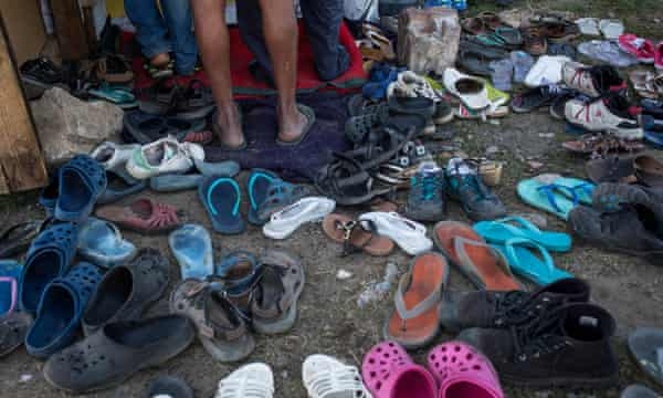 People's shoes left outside the migrant church in Calais