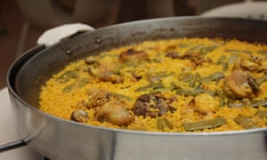 Paella Valenciana, made to the original recipe with rabbit, snails and butter beans, at restaurant Casa Carmella on the beach in Valencia