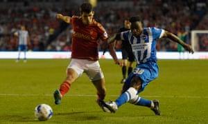Kazenga LuaLua of Brighton scores in the first half despite the efforts of Nottingham Forest's Eric Lichaj.