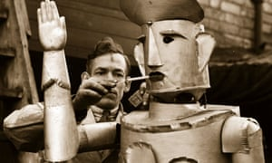 Charles Lawson, an electrical engineer from Kettering. lights his robot's cigarette in 1939. In the future, will the roles be reversed?