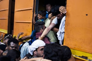 Migrants try to climb on a train heading to the border with Serbia at the train station of Gevgelija, on the Macedonian-Greek border. Many migrants try to cross Macedonia and Serbia to enter the European Union via Hungary, a country that will finish building its anti-migrant fence on its southern border with Serbia by August 31, ahead of a previous November deadline.