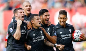 Philippe Coutinho, centre, is mobbed by his Liverpool team-mates after his brilliant late winner put paid to Stoke City.