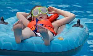Young boy relaxing on a inflatable floating boat