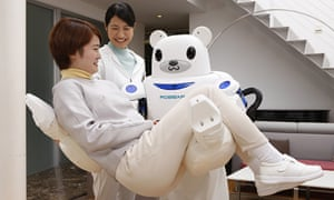 A Robear nursing robot carries a patient during a test exercise in Japan