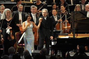 Yuja Wang takes the applause with conductor Michael Tilson Thomas.