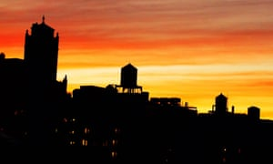 The iconic silhouettes of water tanks at sunset on Manhattan's Upper West Side.