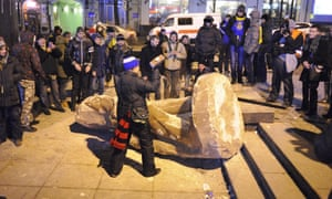 Protesters topple a statue of Lenin in Kiev in December 2013, before the government was overthrown.