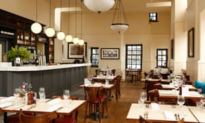 Contini Cannonball restaurant with counter, tables, two hanging lights