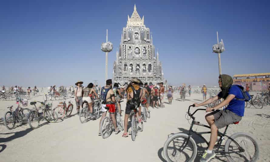 Festivalgoers gather at the Totem of Confessions at Burning Man.