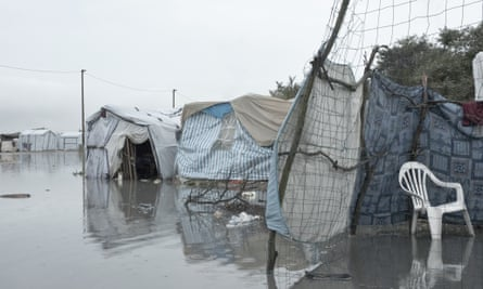 Tents sitting in the flood waters in the Jungle.