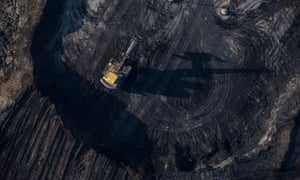Trucks and machinery along routes within the Suncore tar sands site near Fort McMurray in northern Alberta.