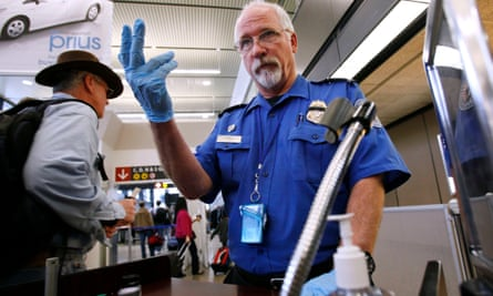 A TSA officer at a security checkpoint in Seattle-Tacoma International airport. All passengers' baggage locks must be branded 'travel sentry approved' in the US.