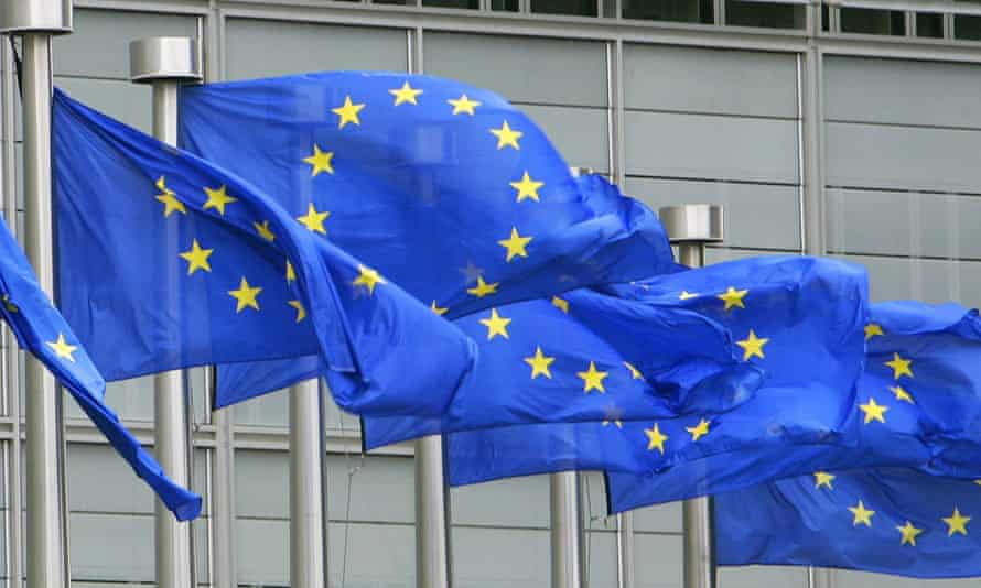 European Union flags outside the European commission headquarters in Brussels.