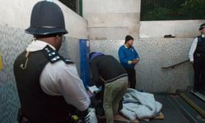 Police help homeless people in London