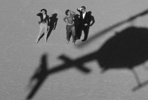 The glamorous world of Von Wangenheim comes with the accessories of the super-rich - such as a helicopter, in shadow in this image, featuring Gia Carangi for Vogue in 1979.