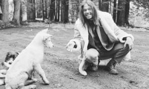 Musician Neil Young offers his dog a cigarette.