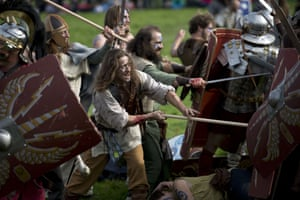 Barbarian hordes clash with soldiers in hand-to-hand combat