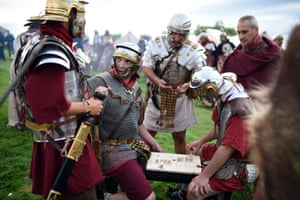 The reenactors, from across Italy, play a Roman board game