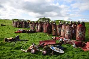 Reenactors play dead after the battle