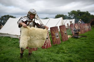 A reenactor portraying a soldier from the Imperial Roman Army prepares for a battle with Caledonian barbarians