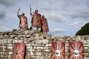 Imperial Roman Army soldiers pose triumphantly