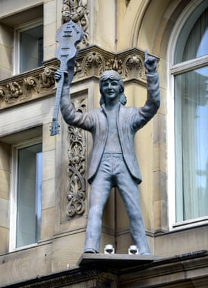 Sir Paul McCartney on the exterior of the Hard Day's Night Hotel, Liverpool, England