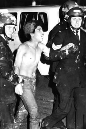 A man is arrested by police during the Toxteth riots.