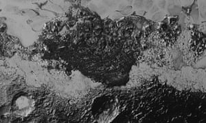 Bright plains and dark craters are visible on Pluto's surface.