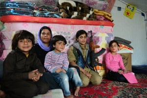 Yazidi fighter Mrali, 16, visits her mother and siblings living in a tent in the Sinjar mountains.