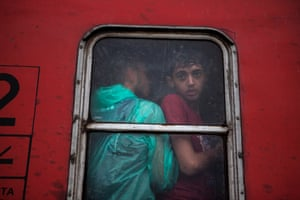 Refugees squeeze on to a train that will take them to the Serbia border with Macedonia.